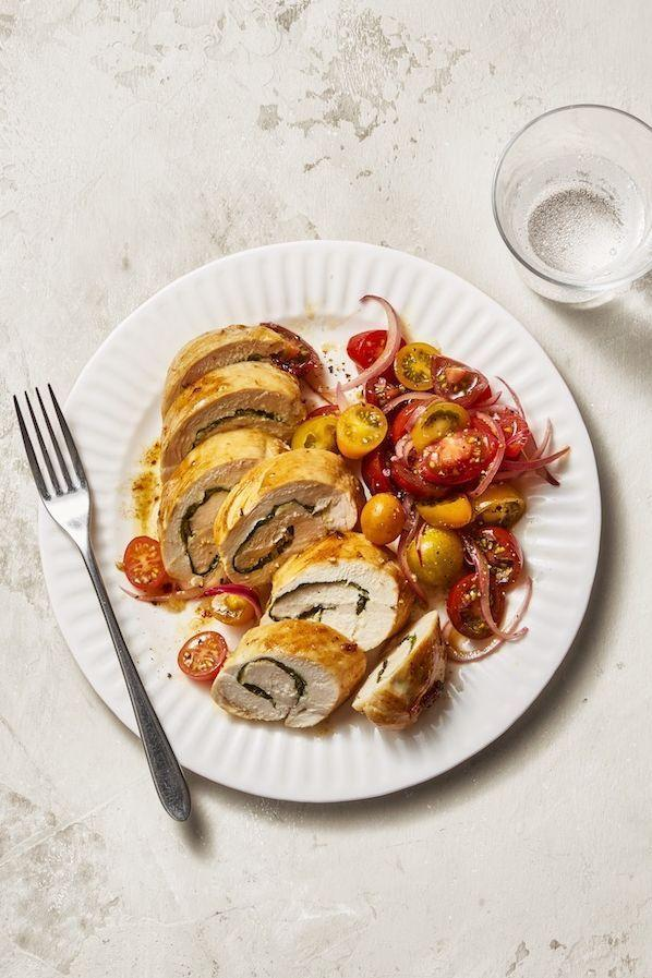 """<p>Stuffing your breasts with parmesan and spinach is a quick way to elevate juicy chicken filets. You'll sear the breast in a pan, finish them in the oven, and marinade a quick tomato salad.</p><p><em><a href=""""https://www.goodhousekeeping.com/food-recipes/a11427/chicken-roulades-recipe-ghk0113/"""" rel=""""nofollow noopener"""" target=""""_blank"""" data-ylk=""""slk:Get the recipe for Chicken Roulades With Marinated Tomatoes »"""" class=""""link rapid-noclick-resp"""">Get the recipe for Chicken Roulades With Marinated Tomatoes »</a></em></p>"""