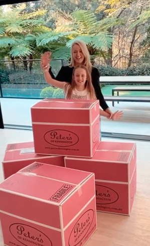 Jackie O and daughter Kitty pose with moving Peters of Kensington boxes in Woollahra mansion