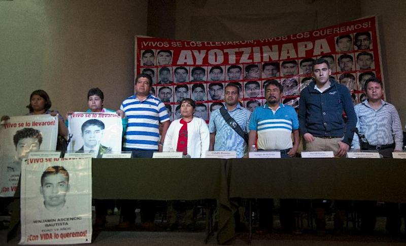 Relatives pose with portraits of the 43 missing students after a press conference in Mexico City, on January 27, 2015