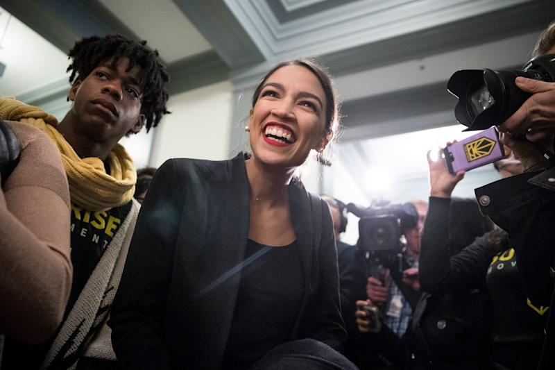 Representative Alexandria Ocasio-Cortez is the Sunrise Movement's most visible advocate— and nothing less than an idol to its membership.