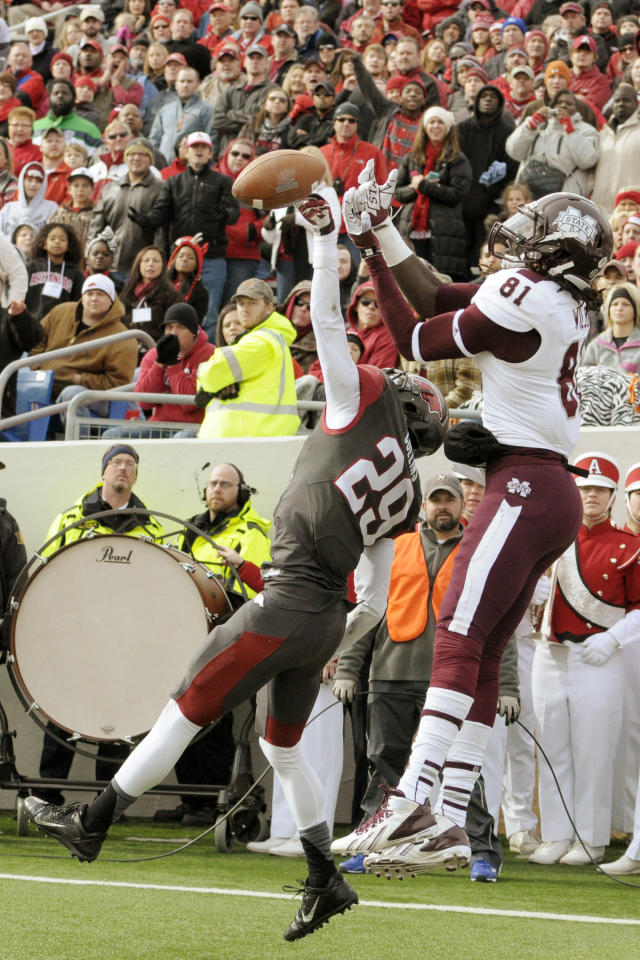 Arkansas cornerback Jared Collins (29) breaks up a pass in the end zone intended forMississippi State wide receiver De'Runnya Wilson (81) during an NCAA college football game in Little Rock, Ark., Saturday, Nov. 23, 2013. (AP Photo/David Quinn)