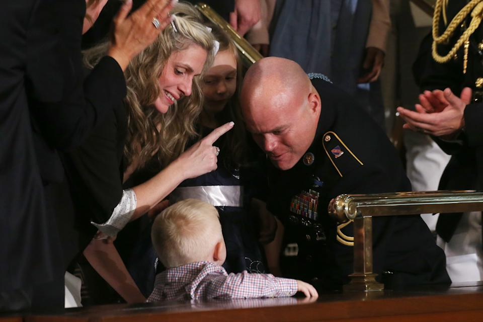 Sgt. 1st Class Townsend Williams surprises his family by returning early from deployment in Afghanistan during the State of the Union address in the chamber of the U.S. House of Representatives on February 04, 2020 in Washington, DC.  (Mario Tama/Getty Images)