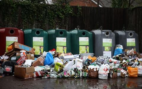 Empty bottles dumped in front of glass recycling bins at a centre near Bracknell, Berkshire. PRESS ASSOCIATION Photo. Picture date: Tuesday January 2, 2018. See PA story ENVIRONMENT Recycling. Photo credit should read: Steve Parsons/PA Wire - Credit:  Steve Parsons/PA