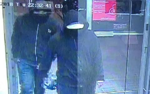 A CCTV image released by police shows two suspects walking in the Bombay Bhel restaurant before the bomb exploded. One is carrying an object - Credit: Peel Regional Police