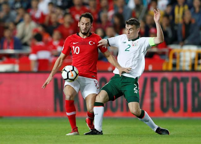 Soccer Football - International Friendly - Turkey vs Republic of Ireland - New Antalya Stadium, Antalya, Turkey - March 23, 2018 Turkey's Hakan Calhanoglu in action with Republic of Ireland's Seamus Coleman REUTERS/Murad Sezer