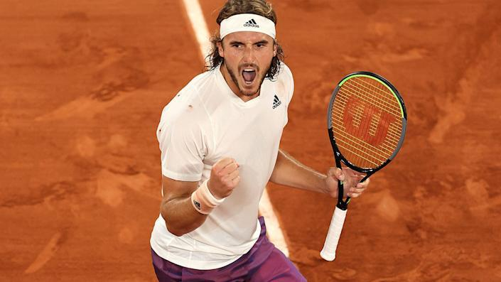 Pictured here, Stefanos Tsitsipas celebrates after beating Daniil Medvedev at the French Open.