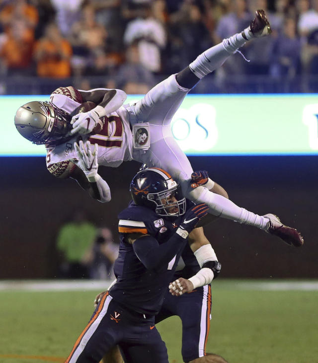 Florida State wide receiver Tamorrion Terry (15) is tackled by Virginia linebacker Jordan Mack (4) during the second half of an NCAA college football game in Charlottesville, Va., Saturday, Sept. 14, 2019. (AP Photo/Andrew Shurtleff)