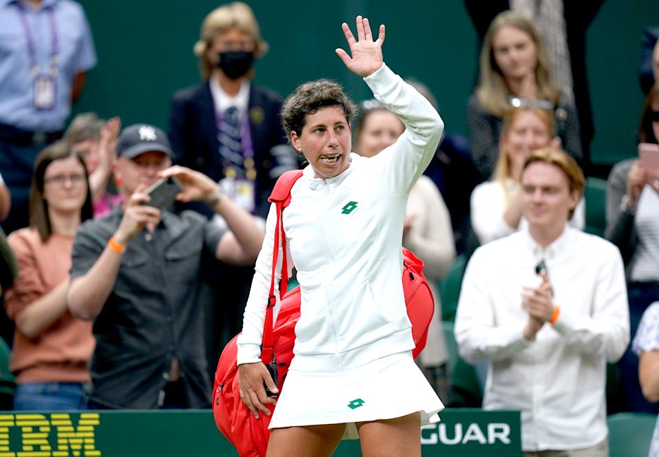 Carla Suarez Navarro (pictured) waves to the fans at the end of her first round ladies' singles match against Ashleigh Barty on centre court on day two of Wimbledon.
