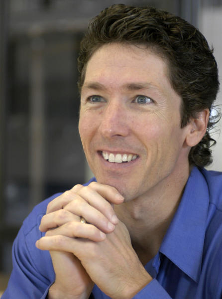 FILE - Lakewood Church pastor Joel Osteen smiles during an interview in the former basketball arena that has become the new home for the church in Houston, in this Sept. 20, 2004, file photo. Authorities are investigating after $600,000 in checks and cash was stolen from a safe at Pastor Joel Osteen's Houston megachurch, which has one of the largest congregations in the country. Police spokesman Kese Smith said Tuesday March 11, 2014 $200,000 in cash and $400,000 in checks were stolen from a safe sometime between 2:30 p.m. Sunday and 8:30 a.m. Monday. (AP Photo/Pat Sullivan)