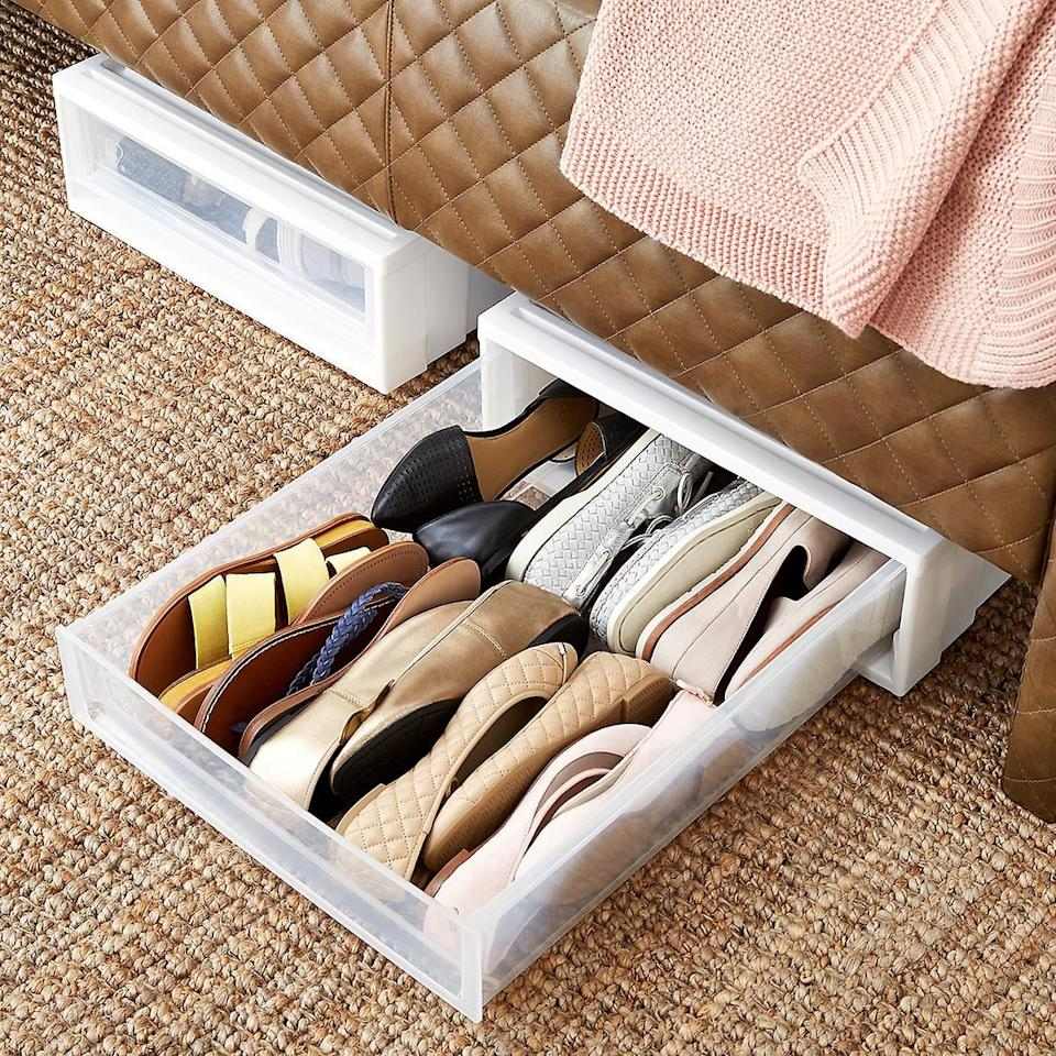 """<p>This <a href=""""https://www.popsugar.com/buy/Under-Bed-Drawer-480437?p_name=Under%20Bed%20Drawer&retailer=containerstore.com&pid=480437&price=23&evar1=casa%3Aus&evar9=46502982&evar98=https%3A%2F%2Fwww.popsugar.com%2Fhome%2Fphoto-gallery%2F46502982%2Fimage%2F46503092%2FUnder-Bed-Drawer&list1=shopping%2Corganizing%2Cfurniture%2Cbedrooms%2Csmall%20space%20living%2Chome%20organization&prop13=api&pdata=1"""" rel=""""nofollow"""" data-shoppable-link=""""1"""" target=""""_blank"""" class=""""ga-track"""" data-ga-category=""""Related"""" data-ga-label=""""https://www.containerstore.com/s/closet/drawers/under-bed-drawer/12d?productId=10000201"""" data-ga-action=""""In-Line Links"""">Under Bed Drawer</a> ($23) is the ideal place to store extra shoes, sweaters, and more.</p>"""