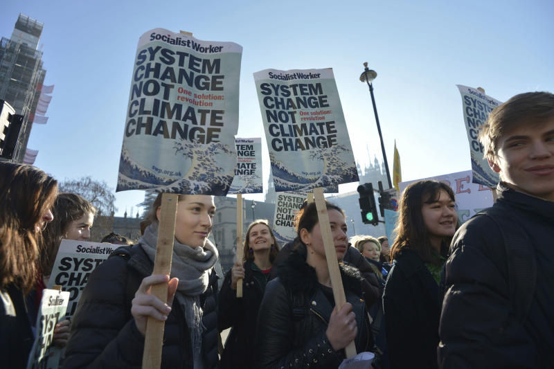 Students join the Youth Strike 4 Climate movement during a climate change protest near Parliament in London, Friday Feb. 15, 2019. The demonstration is one many strikes nationwide to demand action against climate change. (Nick Ansell/PA via AP)