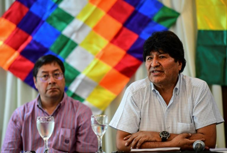 Former Bolivia president Evo Morales (right) sits alongside the presidential candidate for his Movement for Socialism party, Luis Arce