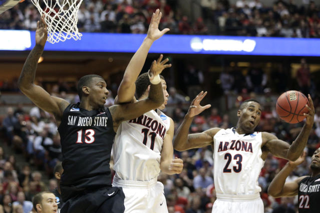 Arizona forward Rondae Hollis-Jefferson (23) pulls down a rebound as teammate Aaron Gordon (11) and San Diego State forward Winston Shepard (13) look over during the first half in a regional semifinal of the NCAA men's college basketball tournament, Thursday, March 27, 2014, in Anaheim, Calif. (AP Photo/Jae C. Hong)