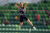FILE - In this June 21, 2021, file photo, Sam Kendricks competes during the finals of the men's pole vault at the U.S. Olympic Track and Field Trials in Eugene, Ore. American world-champion pole vaulter Kendricks will miss the Olympics after testing positive for COVID-19. (AP Photo/Charlie Riedel, File)