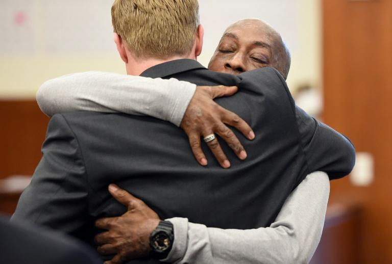 Johnson hugs one of his lawyers after hearing the verdict to his case against Monsanto at the Superior Court Of California