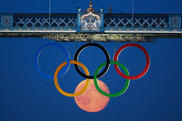 # Moon as Olympic ring The full moon rises through the Olympic Rings hanging beneath Tower Bridge during the London 2012 Olympic Games.