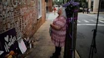 PHOTO: Susan Bro, mother of Heather Heyer, who was killed during the August 2017 white nationalist rally in Charlottesville, stands at the memorial at the site where her daughter was struck by a car in Charlottesville, Va., July 31, 2018. (Brian Snyder/Reuters, FILE)