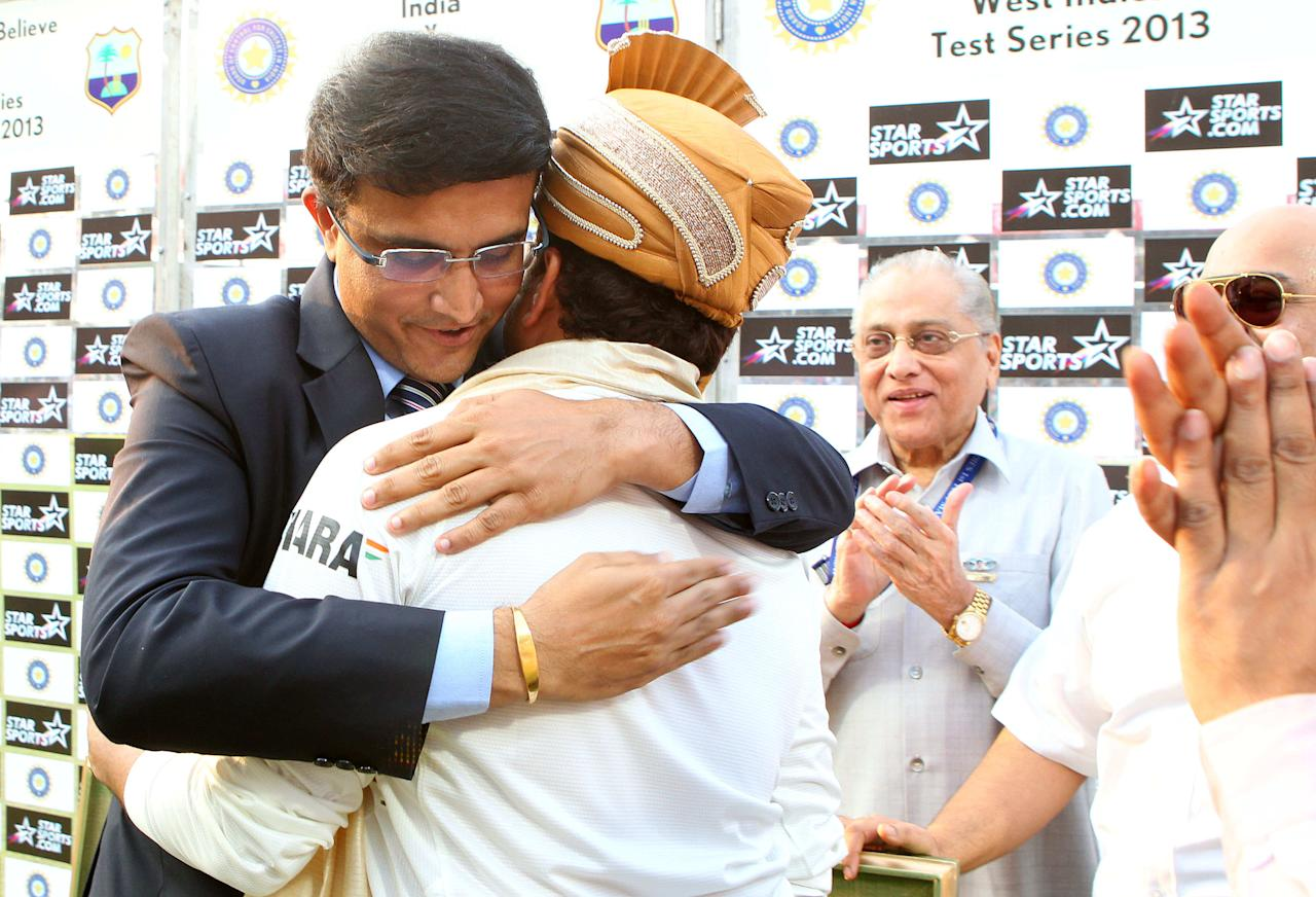 Saurav Ganguly hugs Sachin Tendulkar of India  during day three of the first Star Sports test match between India and The West Indies held at The Eden Gardens Stadium in Kolkata, India on the 8th November 2013  Photo by: Ron Gaunt - BCCI - SPORTZPICS