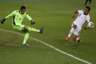 Mexico's goalkeeper Luis Malagon kicks the ball ahead of United States' Sebastian Saucedo during a Concacaf Men's Olympic Qualifying championship soccer match in Guadalajara, Mexico, Wednesday, March 24, 2021. (AP Photo/Fernando Llano)