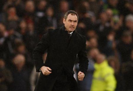 Swansea City manager Paul Clement celebrates after the game
