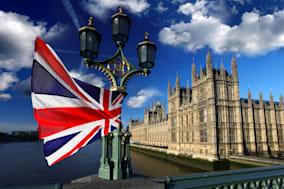 houses of parliament with flag...