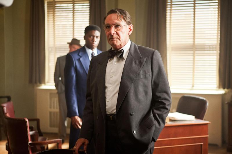 """This publicity film image released by Warner Bros. Pictures shows Chadwick Boseman, background left, as Jackie Robinson and Harrison Ford as Branch Rickey in a scene from """"42."""" (AP Photo/Warner Bros. Pictures, D. Stevens)"""