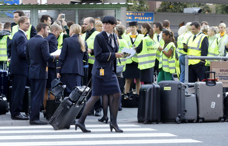 Cabin attendants take part in a demonstration at the Frankfurt airport as the flight attendants of German Lufthansa airline went on a seven hour strike at the international airport on Friday morning, Aug. 31, 2012 in Frankfurt, Germany, causing at least 60 cancelled flights. More and longer lasting strikes are announced for the next days and weeks.(AP Photo/Michael Probst)
