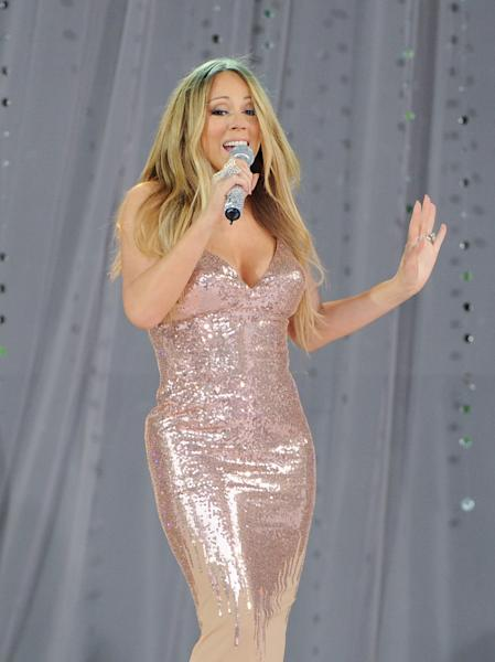 "FILE - In this May 24, 2013 file photo, singer Mariah Carey performs on ABC's ""Good Morning America"" in Central Park in New York. Carey is in the hospital for a shoulder injury. The pop star's representative says the singer went to the hospital late Sunday, July 7, 2013, after injuring her shoulder while filming a music video. (Photo by Evan Agostini/Invision/AP, File)"