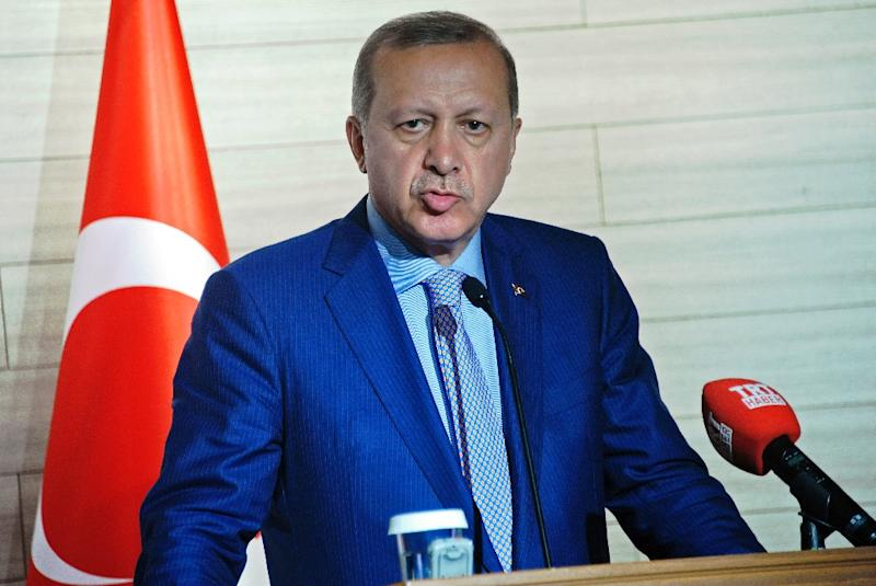 "President Recep Tayyip Erdogan sparked outrage by suggesting that Syrians could eventually be granted Turkish citizenship ""if they want it"" (AFP Photo/Mohamed Abdiwahab)"