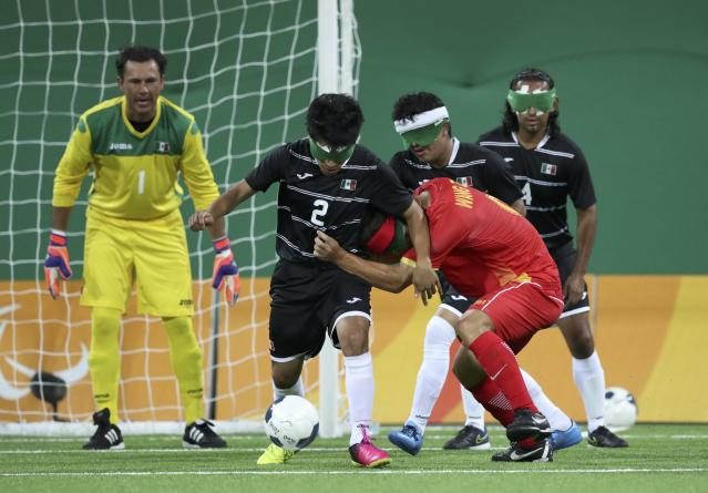 2016 Rio Paralympics - Football Soccer - Men's 5-a-side Preliminaries Pool B - China v Mexico - Olympic Tennis Centre - Rio de Janeiro, Brazil - 11/09/2016. Francisco Rangel (MEX) of Mexico in action with Wang Zhoubin (CHN) of China. REUTERS/Ueslei Marcelino FOR EDITORIAL USE ONLY, NOT FOR SALE FOR MARKETING OR ADVERTISING CAMPAIGNS.