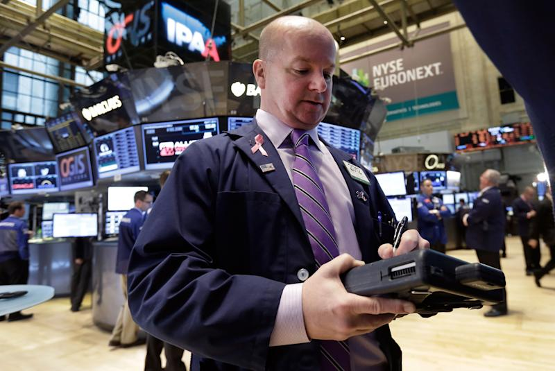Trader Patrick Casey works on the floor of the New York Stock Exchange, Monday, April 7, 2014. Stocks are starting out the week the same way they ended the last one — down. (AP Photo/Richard Drew)