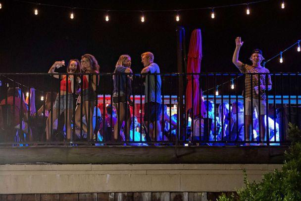 PHOTO: Patrons stand on the Bear Trap's rooftop bar on The Strip, the University of Alabama's bar scene, Aug. 15, 2020, in Tuscaloosa, Ala. (Vasha Hunt/AP)