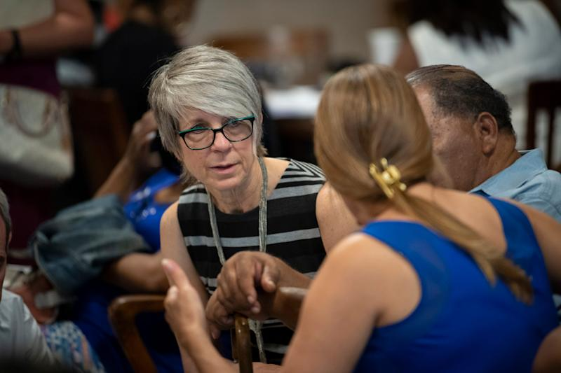 Beth Shay of the Philadelphia Senior Law Center discusses a reverse mortgage case with a resident as part of the Philadelphia Municipal Courts Residential Mortgage Foreclosure Diversion Program. -