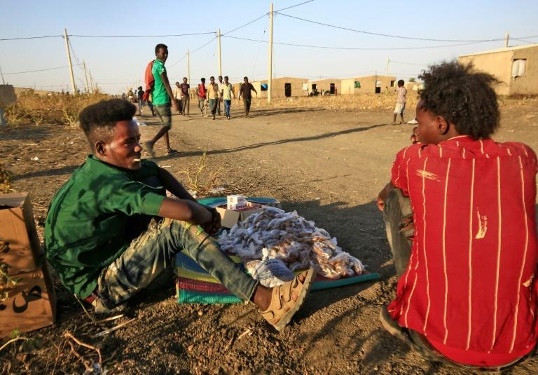 Ethiopian refugees who had savings quickly bulk-bought food and other goods that they can sell after fleeing into Sudan