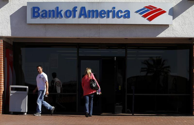 Customers are seen outside of a Bank of America in Tucson