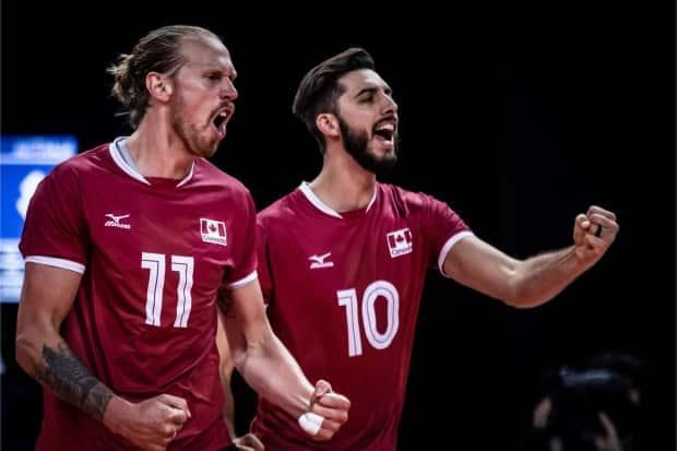 Ryan Sclater, of New Westminster, B.C., right, was Canada's leading scorer in the victory over Australia on Tuesday. (Volleyball World - image credit)