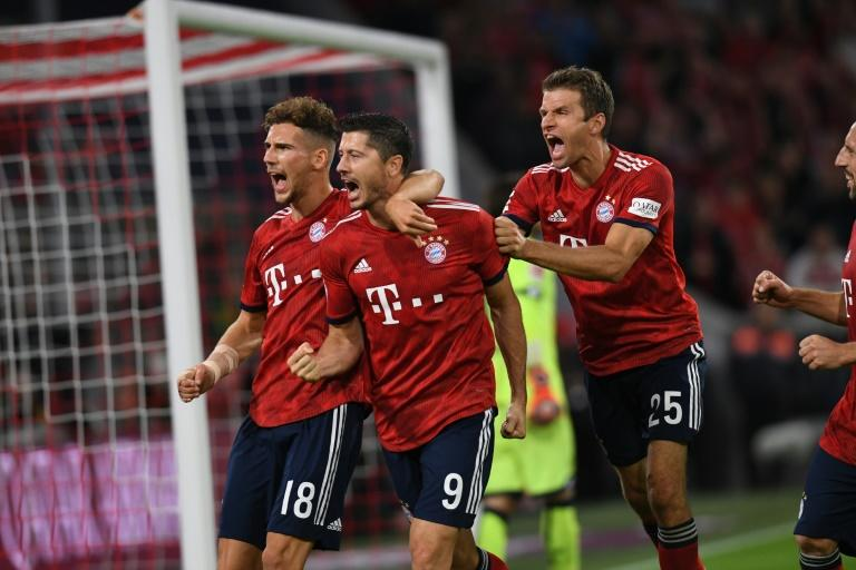 Bayern Munich striker Robert Lewandowski (C), the Bundesliga's top scorer last season with 29 goals in 30 games, will be looking to add to his tally of five goals in 13 games against Stuttgart on Saturday