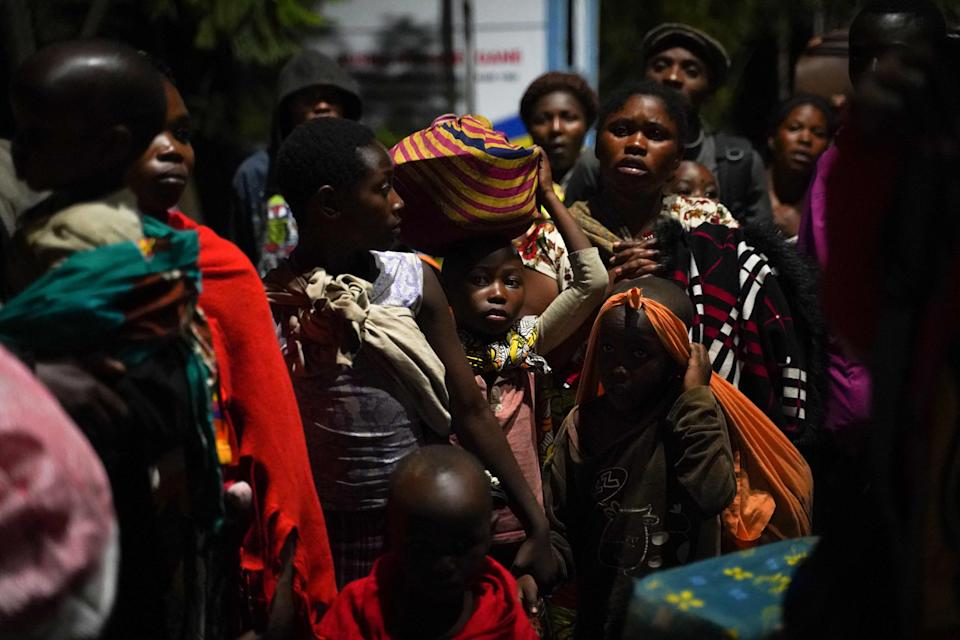 People carry their belongings as they flee from Goma, Democratic Republic of CongoAFP via Getty Images