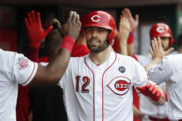 FILE - In this May 31, 2019, file photo, Cincinnati Reds' Curt Casali celebrates in the dugout after hitting a three-run home run off Washington Nationals starting pitcher Patrick Corbin in the first inning of a baseball game in Cincinnati. Ten current or retired Major League Baseball players have helped developed an outdoor, interactive game called CupCheck. Reds catcher Curt Casali is part of the venture, which has partnered with the Testicular Cancer Society based in Cincinnati. (AP Photo/John Minchillo, File)