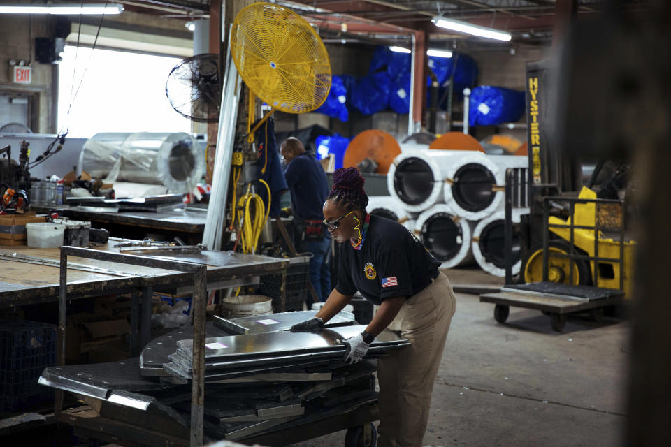 Sheet metal worker Carey Mercer assembles ductwork at Contractors Sheet Metal on Tuesday, Aug. 3, 2021, in New York. The construction industry is fighting to recruit more women into a sector that faces chronic labor shortages. As spending on infrastructure rises, construction firms will need to hire at least 430,000 new skilled laborers in 2021, according to an analysis of federal data by the Associated Builders and Contractors. Right now, only 4% of construction laborers in the U.S. are women, according to the Bureau of Labor Statistics (AP Photo/Kevin Hagen)
