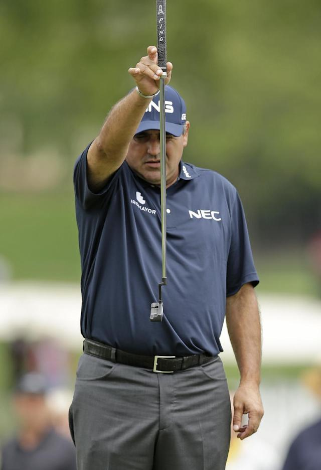 Angel Cabrera, of Argentina, lines up a putt on the 10th hole during the second round of the Wells Fargo Championship golf tournament in Charlotte, N.C., Friday, May 2, 2014. (AP Photo/Chuck Burton)