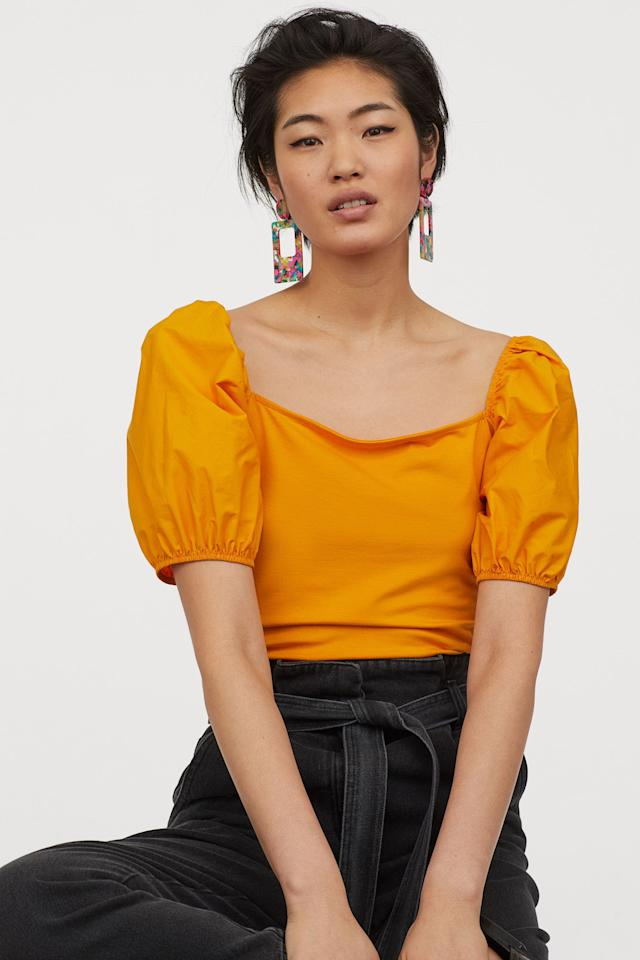 """<p>Dress up any pair of trousers with this bright <a href=""""https://www.popsugar.com/buy/HampM-Puff-sleeved-Top-555268?p_name=H%26amp%3BM%20Puff-sleeved%20Top&retailer=www2.hm.com&pid=555268&price=10&evar1=fab%3Aus&evar9=45826546&evar98=https%3A%2F%2Fwww.popsugar.com%2Ffashion%2Fphoto-gallery%2F45826546%2Fimage%2F47293418%2FHM-Puff-sleeved-Top&list1=shopping%2Ch%26m%2Cspring%2Cspring%20fashion%2Caffordable%20shopping&prop13=api&pdata=1"""" rel=""""nofollow"""" data-shoppable-link=""""1"""" target=""""_blank"""" class=""""ga-track"""" data-ga-category=""""Related"""" data-ga-label=""""https://www2.hm.com/en_us/productpage.0818031004.html"""" data-ga-action=""""In-Line Links"""">H&amp;M Puff-sleeved Top</a> ($10).</p>"""