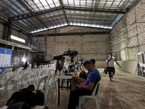 Journalists wait for a press conference at a temporary media centre in Manila (Getty)