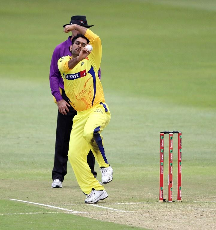 Mahendra Singh Dhoni of the Chennai Super Kings bowls on October 22, 2012 during a Champions League T20 (CLT20) match against Yorkshire at the Kingsmead stadium in Durban. AFP PHOTO / STR