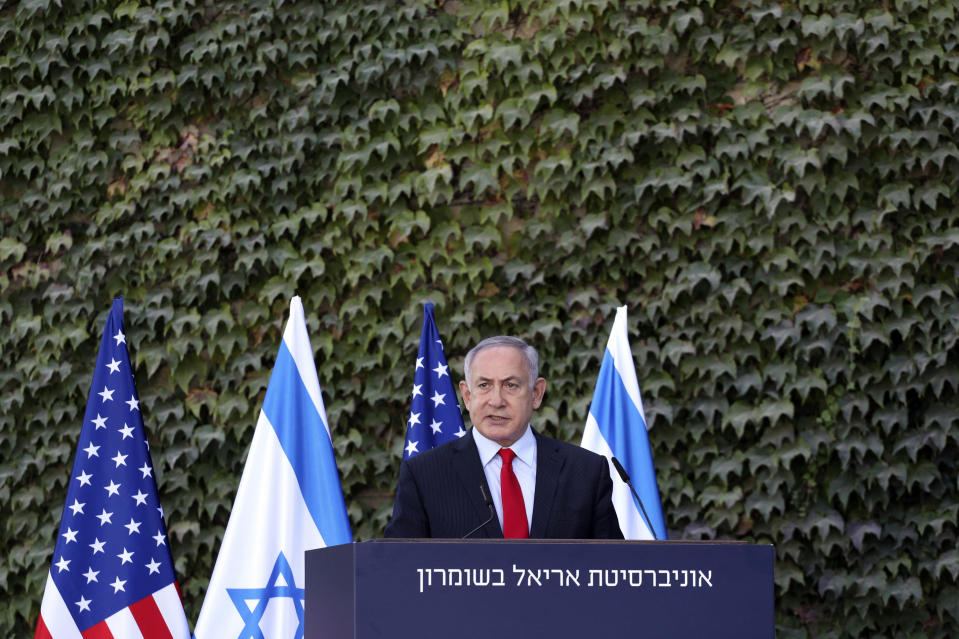 Israeli Prime Minister Benjamin Netanyahu speaks during a ceremony to sign amendments to a series of scientific cooperation agreements with U.S. Ambassador to Israel David Friedman, at Ariel University, in the West Bank settlement of Ariel, Wednesday, Oct. 28, 2020. The United States and Israel amended the agreements on Wednesday to include Israeli institutions in the West Bank, a step that further blurs the status of settlements widely considered illegal under international law. (Emil Salman/Pool via AP)