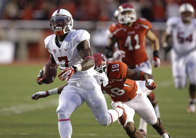 Stanford wide receiver Ty Montgomery (7) carries the ball as Utah defensive back Eric Rowe (18) makes a diving tackle during the second half of an NCAA college football game on Saturday, Oct. 12, 2013, in Salt Lake City. Utah won 27-21. (AP Photo/Rick Bowmer)