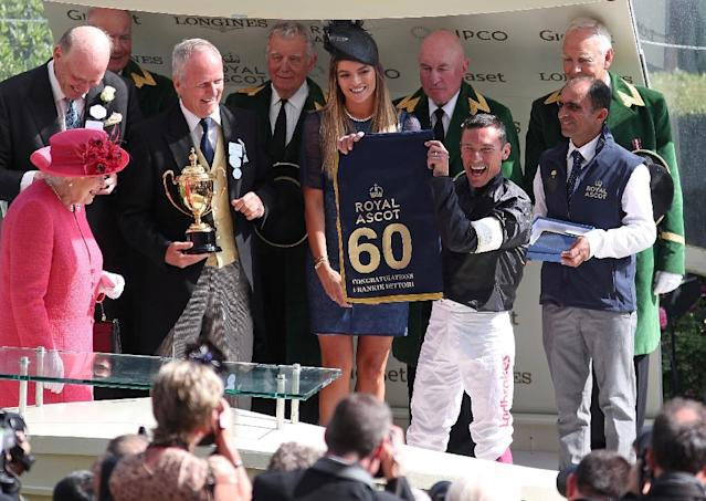 Queen Elizabeth II presented Frankie Dettori with a saddle cloth to commemorate his 60th winner at Royal Ascot after winning the Ascot Gold Cup on Stradivarius, the Italian describing receiving the trophy from the Queen as 'a magical moment' (AFP Photo/Daniel LEAL-OLIVAS)