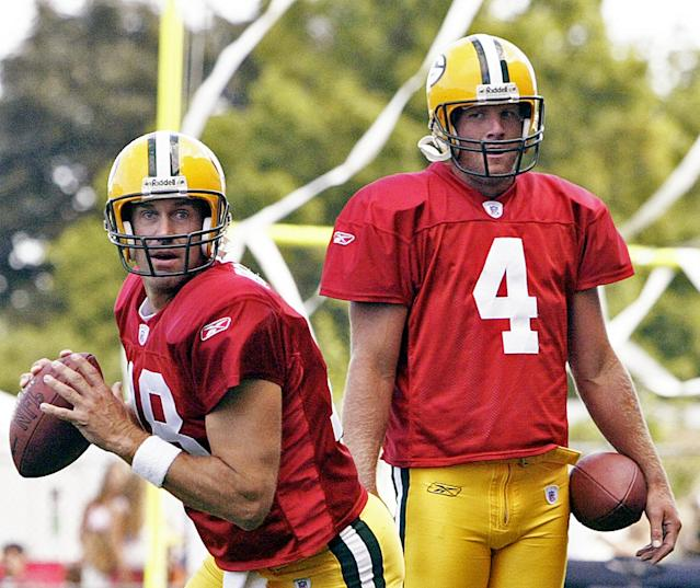 Brett Favre (4) watches Doug Pederson (18) drop back during a Packers practice in 2004. (AP)