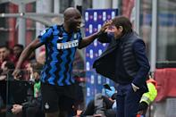 Romelu Lukaku (L) celebrates with coach Antonio Conte during Inter's victory in the Milan derby that put them four points clear at the top of Serie A
