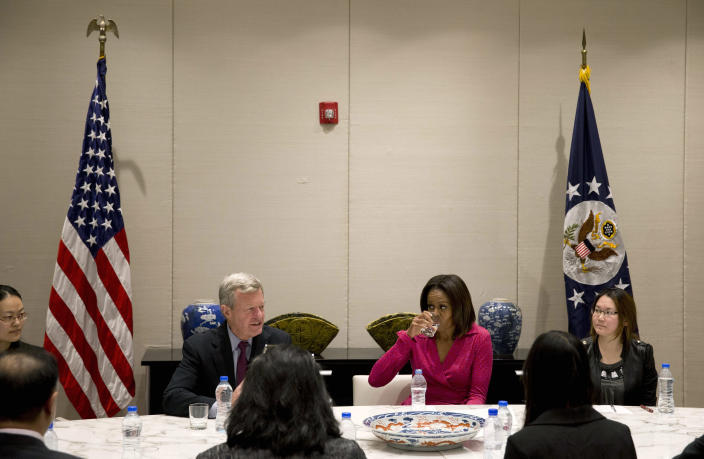 U.S. first lady Michelle Obama, center right, drinks water as U.S. Ambassador to China Max Baucus, center left, speaks during a round table discussion on education at the U.S. Embassy in Beijing, China Sunday, March 23, 2014. (AP Photo/Andy Wong)